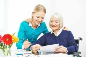 Aged Care worker helping